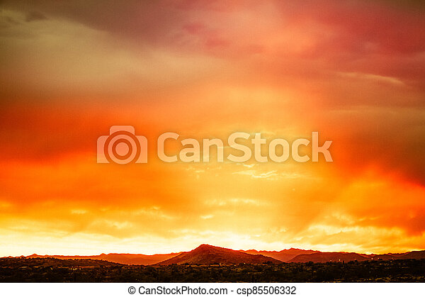 A dramatic cloudy sunset in the desert of Arizona - csp85506332