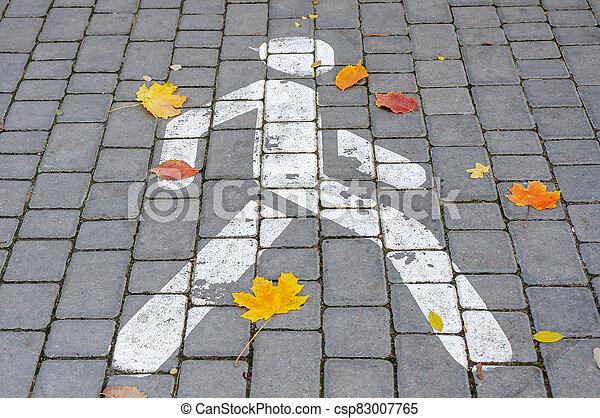 A drawn pedestrian zone sign on asphalt. - csp83007765