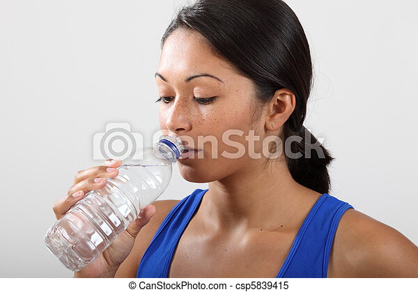 A drink of water after a workout - csp5839415