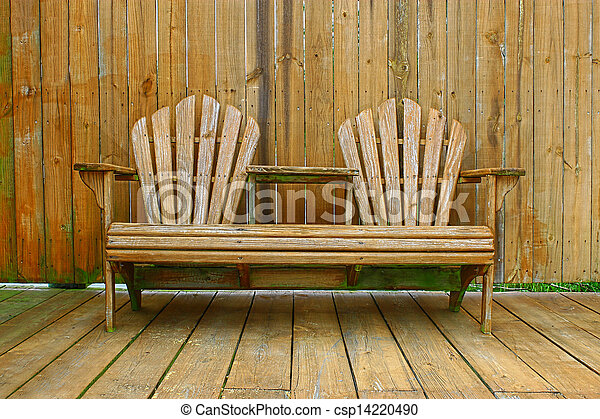 Prime A Dual Wooden Seat With A Center Table On A Wooden Deck Patio With A Fence Behind It For Privacy Short Links Chair Design For Home Short Linksinfo