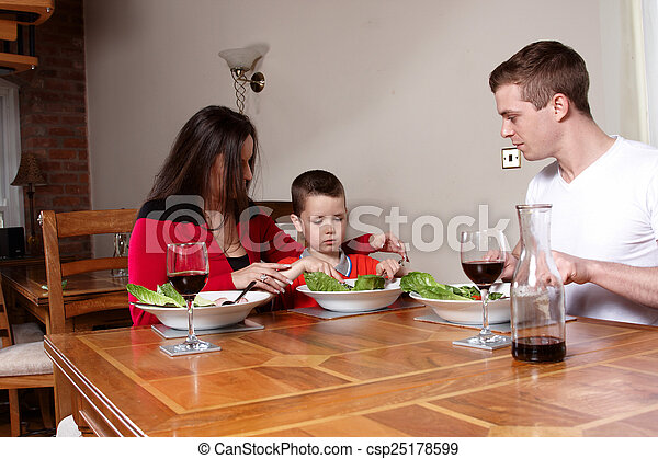 A family having a meal - csp25178599