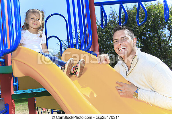 A Father and daughter playing on a slide - csp25470311