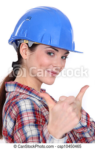 A female construction worker with both thumbs up. - csp10450465