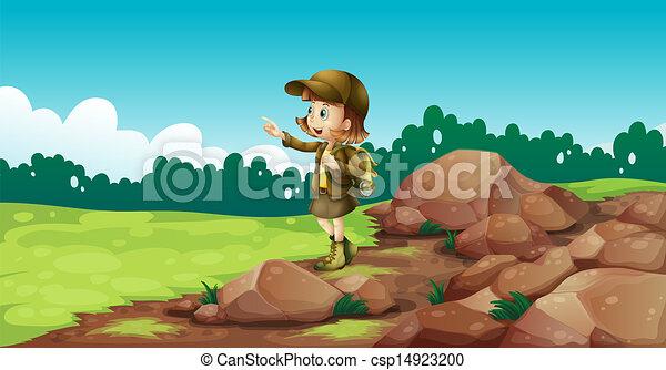 A female explorer near the rocks - csp14923200