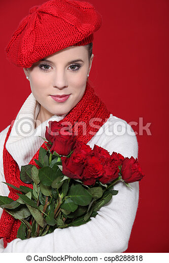 A female model holding a bunch of red roses. - csp8288818