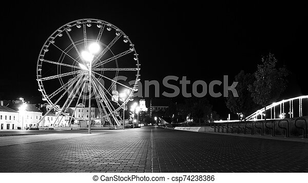 a ferris wheel in downtown Gyor b&w - csp74238386
