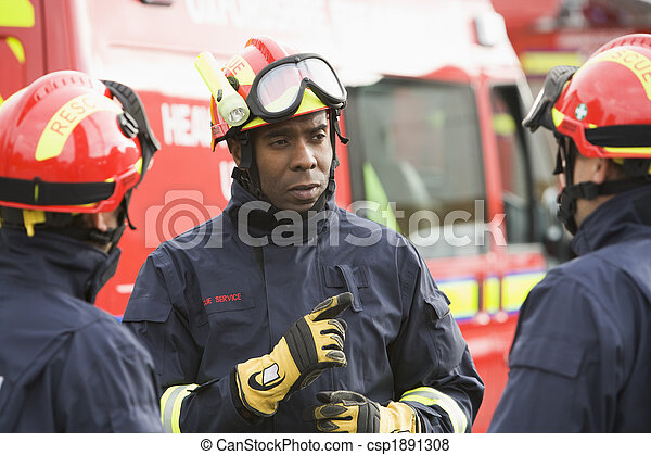A firefighter giving instructions to his team - csp1891308