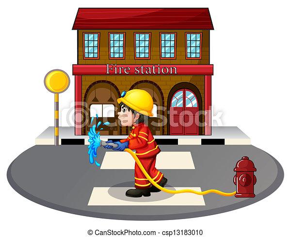 A fireman holding a fire hose near a hydrant - csp13183010