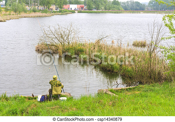 A fisherman fishing on the lake - csp14340879