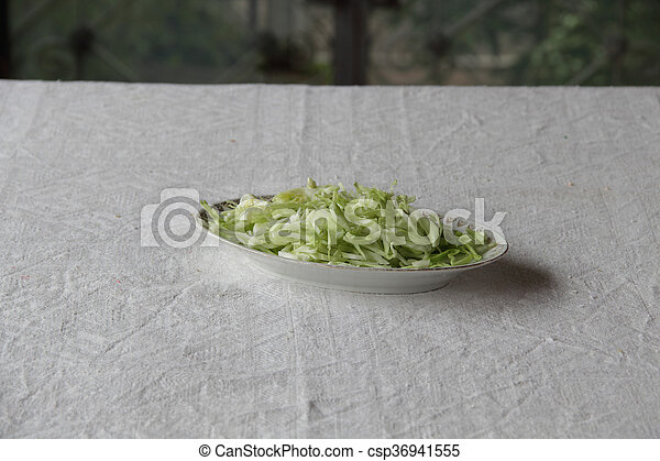 a fresh salad in plate on table - csp36941555