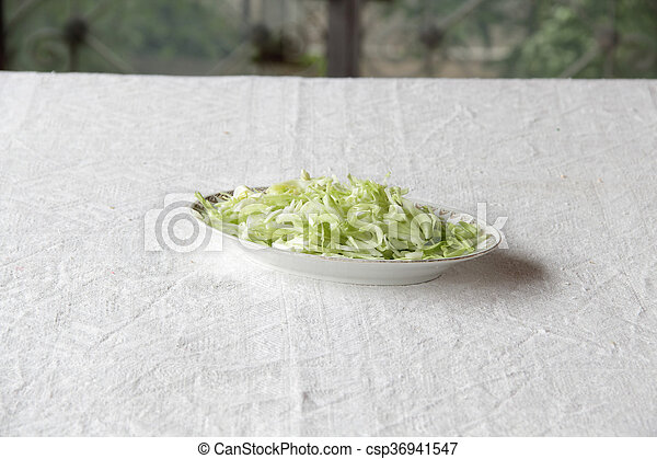 a fresh salad in plate on table - csp36941547