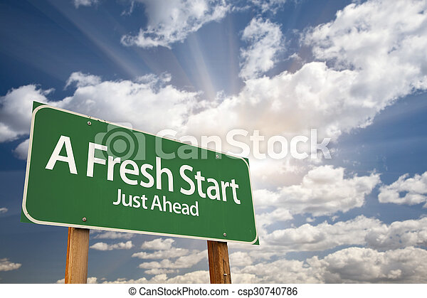 A Fresh Start Green Road Sign Over Clouds - csp30740786