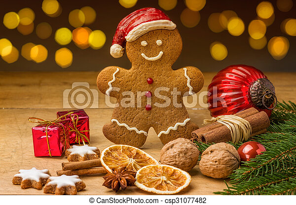 A gingerbread santa with christmas decorations - csp31077482