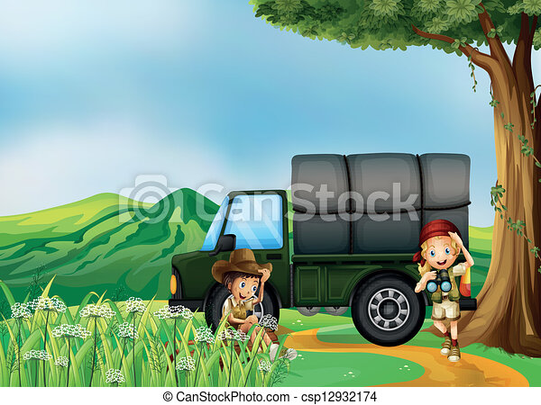 A girl and a boy beside the green truck - csp12932174
