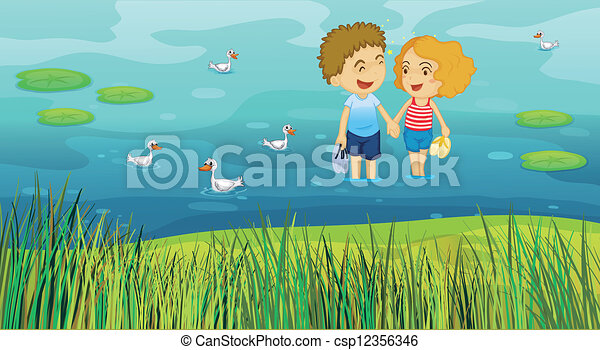 A girl and a boy in the pond - csp12356346