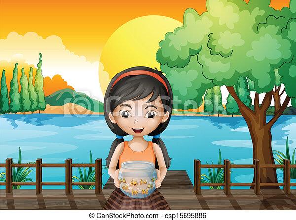 A girl at the bridge holding an aquarium - csp15695886