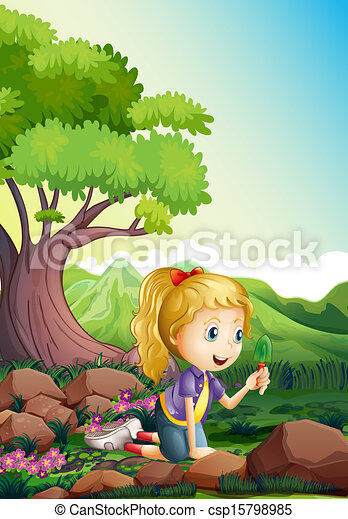 A girl at the forest holding a shovel - csp15798985