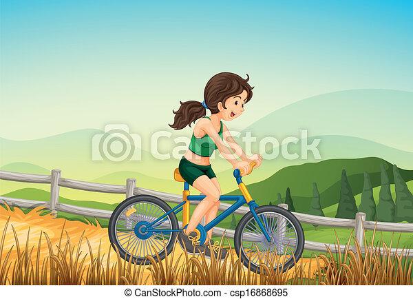 A girl biking at the farm - csp16868695