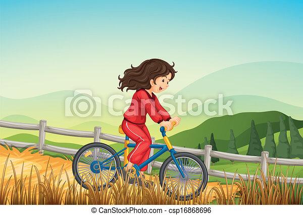 A girl biking at the farm - csp16868696