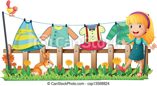 A girl in the garden in front of the hanging clothes - csp13568824