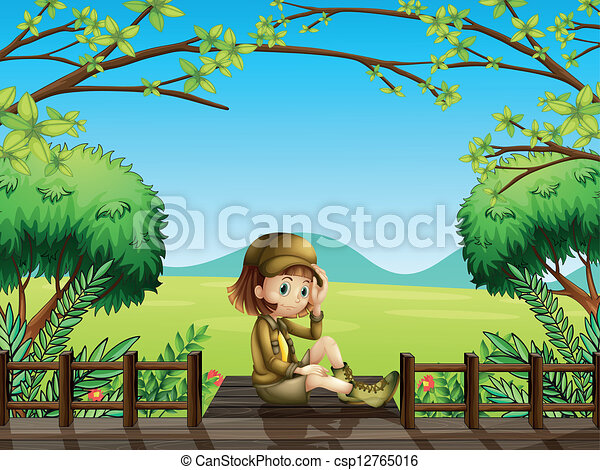 A girl sitting at the wooden bridge - csp12765016