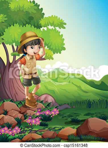 A girl standing above the rock near the giant tree - csp15161348