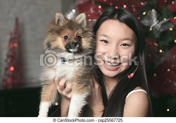 A Girl with dog inside his house - csp25567725