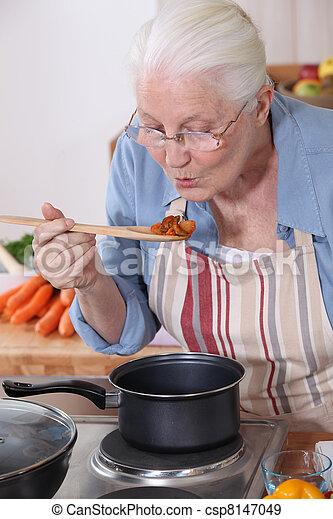 A grandmother cooking. - csp8147049
