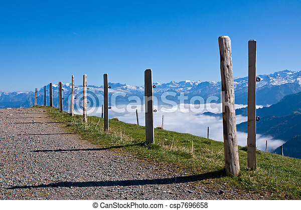 A gravel road up in the alps - csp7696658