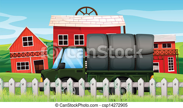 A Green Cargo In Front Of Barn Inside The Fence