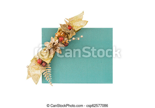 A green gift box with gold gift bow on white background - csp62577086