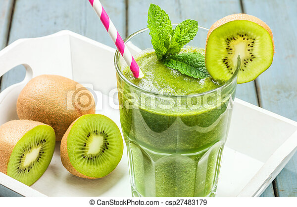 A green smoothie on a tray with kiwi - csp27483179