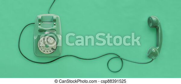 A green vintage dial telephone. - csp88391525