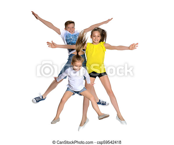 A group of children jumping and waving. - csp59542418