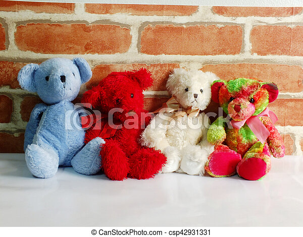 A Group Of Cute Teddy Bears Sitting Together Against With Wallpaper