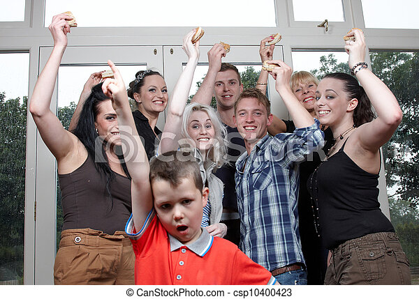 A group of people cheering - csp10400423