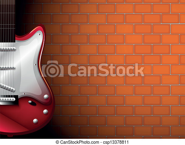 A guitar in front of a brick wall - csp13378811