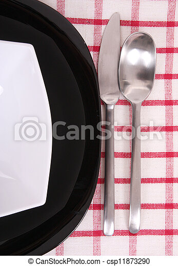 A half of black and white plate with utensils - csp11873290
