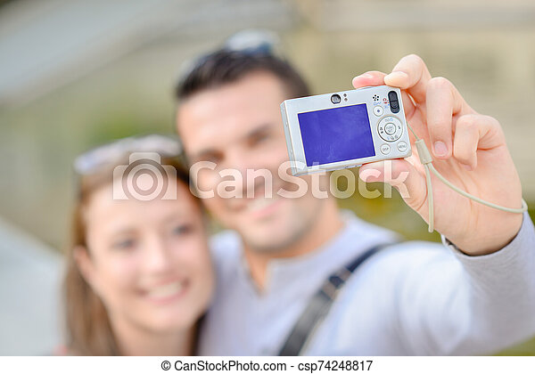 a happy couple say cheeese - csp74248817
