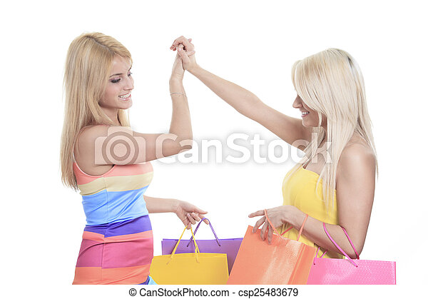 A Happy female shoppers smiling - isolated over a white backgrou - csp25483679