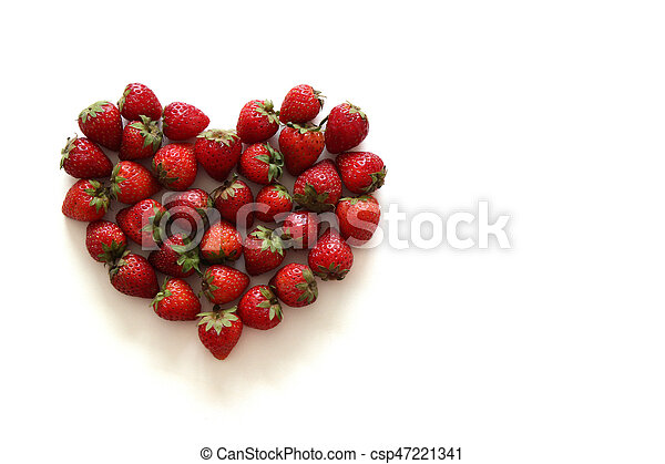 A heart from strawberry on the white background. - csp47221341