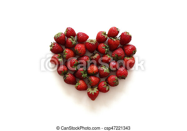 A heart from strawberry on the white background. - csp47221343