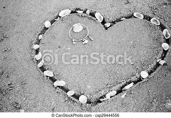 a heart on the sand in the beach black and white color tone style - csp29444556