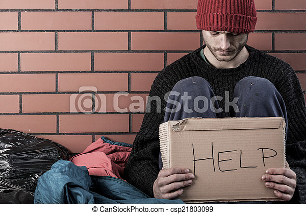 A homeless man need money  - csp21803099