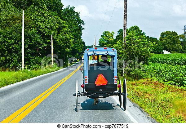 A horse pulling a cart across a beautiful Saskatchewan landscape - csp7677519