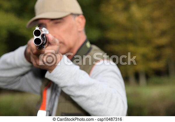A hunter aiming his rifle - csp10487316
