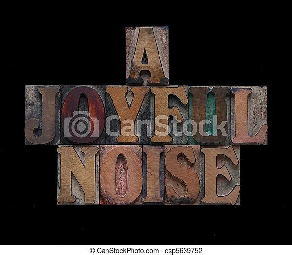 a joyful noise in old wood type - csp5639752