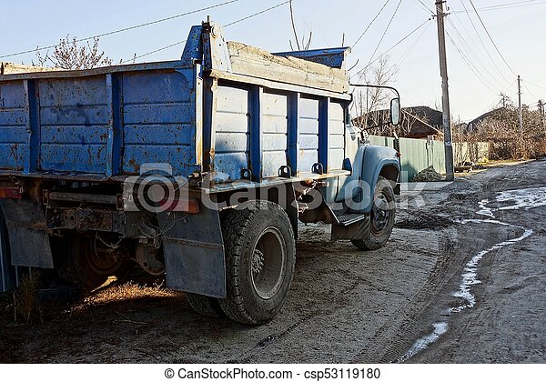 a large old truck stands outside in the fence - csp53119180