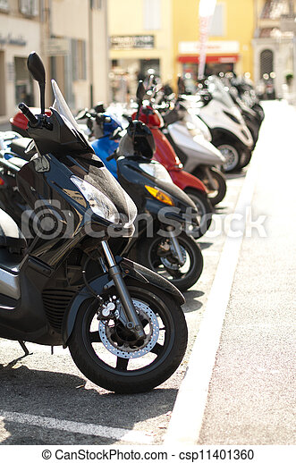 A line of mopeds/scooters - csp11401360