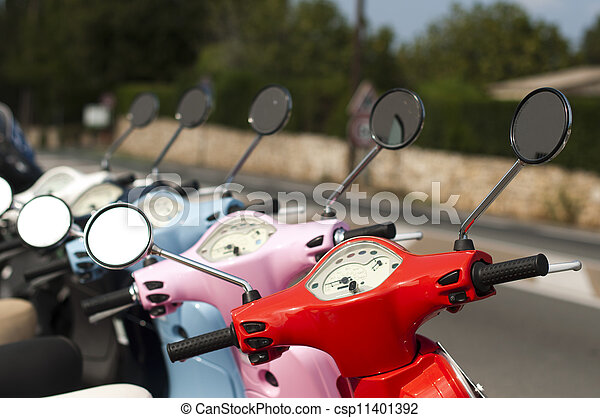 A line of mopeds/scooters - csp11401392